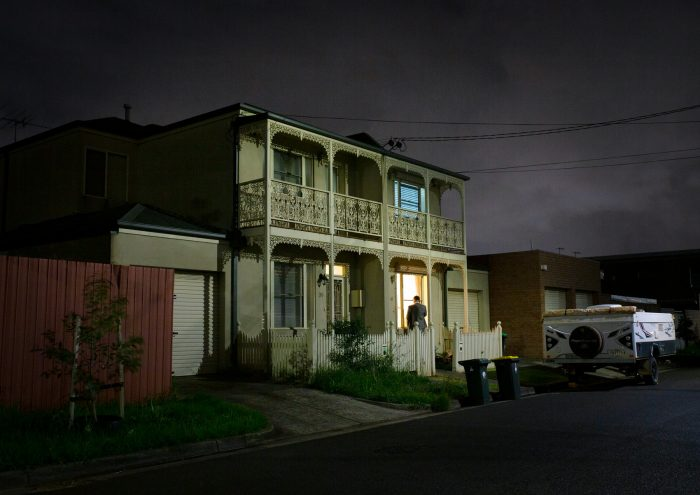 A terrace house photographed at night.